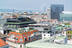 Panorama with rooftop cafe, Vienna, Austria. Panorama with rooftop cafe, Flak Towers, Millennium Tower and Raiffeisen House off north tower of St. Stephen's Royalty Free Stock Image