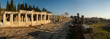 Panorama of the ruins of the ancient city, shot at sunset against the blue sky royalty free stock image