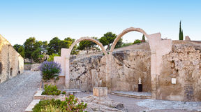 Panorama of the ruins the chapel in the castle Santa Barbara, with preserved arches and figures saints. Stock Photo