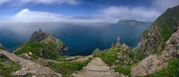 Panorama ruins of the old lighthouse on the high steep bank. Royalty Free Stock Photography
