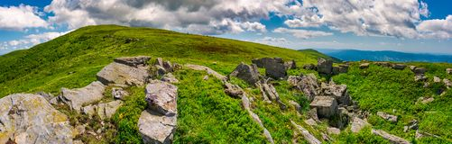 Panorama of Runa mountain with rocks on hillside. Gorgeous landscape of amazing Carpathian mountains on a summer day with beautiful cloudscape on a blue sky Royalty Free Stock Photography