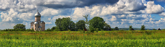 Panorama of the Russian landscape with orthodox church. Large-format panorama of a summer Russian landscape with orthodox church in the neighborhood of Novgorod royalty free stock photos