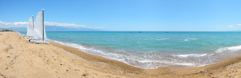 Panorama of sail yachts on the beach on Ionian Sea Stock Photo
