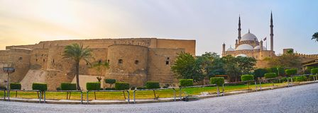 Panorama of Saladin Citadel with preserved medieval wall, huge towers, rising Alabaster mosque and ornamental garden around the stock image