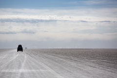 Panorama of the Salar of Uyuni with silhouette of 4x4 cars, Boli Royalty Free Stock Photography