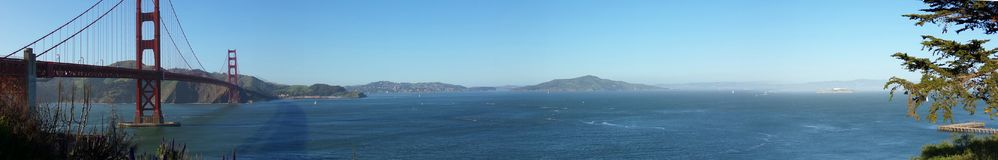 Panorama of the San Francisco Bay with the Golden Gate Bridge. Panoramic View of the San Francisco Bay with the Famous Golden Gate Bridge Stock Photos