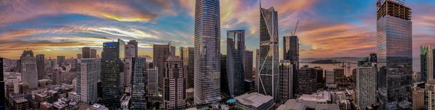 San Francisco skyline with amazing pink red and blue sunset focusing on the Salesforce Tower in the center. Panorama of San Francisco skyline with amazing pink stock photo
