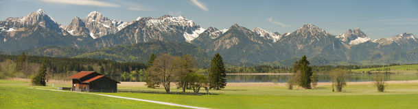 Panorama scene in Bavaria with alps mountains Royalty Free Stock Image