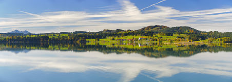 Panorama scene in Bavaria with mountains mirroring in lake Stock Photo