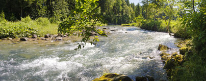 Panorama scene of river Ammer with mountains Royalty Free Stock Photos