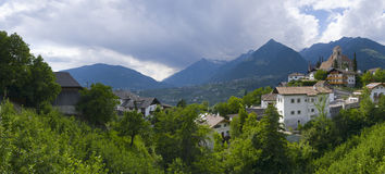 Panorama from Scenna to Merano. Panorama view on the village Merano / South Tyrol with the Castle Schenna on the right side, as well as the mountain of the royalty free stock photos