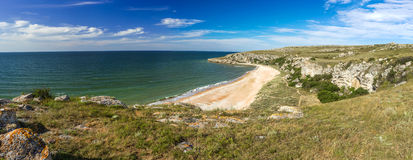 Panorama of the sea coast with rocks. And sand beach Royalty Free Stock Image