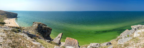 Panorama of the sea coast with rocks. And sand beach royalty free stock images
