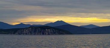 Panorama of sea coast at sunset Stock Image