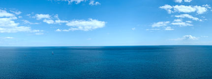Panorama of a sea landscape. With white clouds and the quiet blue water stock images