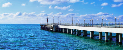 Panorama of sea pier at summer day. Seascape background Stock Photos