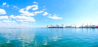 Panorama of the sea port. Cranes and ships. Royalty Free Stock Photo