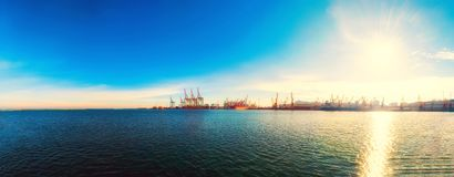 Panorama of the sea port. Cranes and ships. Bulk carrier ship in royalty free stock photos