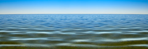 Panorama of sea waves against the blue sky Stock Images