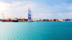 Panorama of seaport. Panoramic view of seaport with cargo ship and containers. Summer day Stock Photography