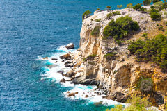 Panorama of seascape, waves and rocky cliff coast, Thassos Island, Greece Stock Photos