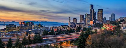 Panorama of Seattle downtown skyline beyond the I-5 I-90 freeway interchange at sunset with long exposure traffic trail lights. From Dr. Jose Rizal or 12th stock photos