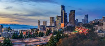 Panorama of Seattle downtown skyline beyond the I-5 I-90 freeway interchange at sunset with long exposure traffic trail lights. From Dr. Jose Rizal or 12th royalty free stock photography
