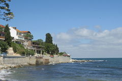 Panorama Seaview on little houses village  in ocean beach. Exotic Panorama Seaview with little houses village  on Black sea beach in Neseber city in Bulgaria Stock Photography