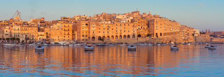 Panorama of Senglea peninsula in the morning, Malta. Valetta Grand harbor in the morning, Senglea peninsula across the bay from Vittoriosa, toned panoramic image Royalty Free Stock Photography