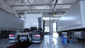 Panorama at the service station of trucks with semi-trailers and refrigerators