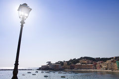 Panorama a Sestri Levante. Panorama to Sestri Levante with lamp-post and sun Stock Photography