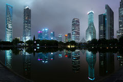 Panorama of Shanghai skyscraper buildings and reflection in lake Royalty Free Stock Photos