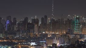 Panorama of Sharjah and Dubai from Ajman rooftop night timelapse, United Arab Emirates. Panorama of Sharjah and Dubai from Ajman rooftop night timelapse, with royalty free stock image