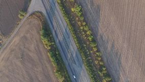Panorama shooting rising upwards on highway and fields. Aerial view stock video footage