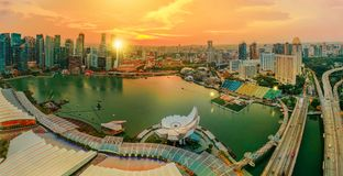 Panorama Marina bay Singapore. Panorama of Singapore Marina Bay with Financial District skyscrapers at sunset light reflected on the harbor. Roof top with Royalty Free Stock Photo