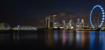 Panorama of Singapore's Skyline at Night Stock Images