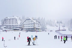 Panorama of ski resort Kopaonik, Serbia, skiers, lift, pine trees Stock Image