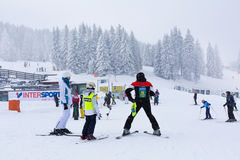 Panorama of ski resort Kopaonik, Serbia, skiers, pine trees Royalty Free Stock Photos