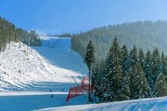 Panorama of ski resort, slope, people on the ski lift Stock Photo