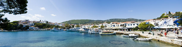 Panorama of port in Skiathos island, Greece. Famous destination place of cruises, very attractive for tourists royalty free stock images