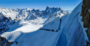 Panorama with skiers heading for Vallee Blanche, France Stock Image