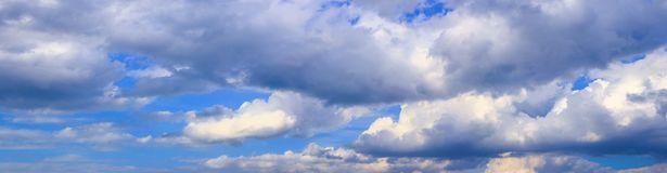 Panorama sky and big storm cloud summer art in nature beautiful background with copy space add text.  Stock Image