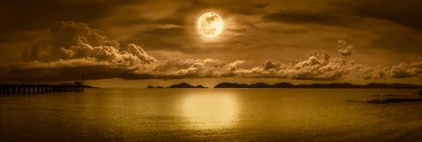 Panorama of sky with full moon on seascape to night. Stock Image