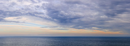 Panorama of sky over water Stock Images