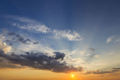 Panorama of sky at sunrise or sunset. Beautiful view of dark blu. E clouds lit by bright orange yellow sun on clear sky. Beauty and power of nature, meteorology royalty free stock image