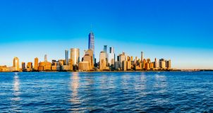 Panorama of skyline of downtown Manhattan over Hudson River under blue sky, in New York City, USA. Panoramic view of skyline of downtown Manhattan over Hudson stock photography