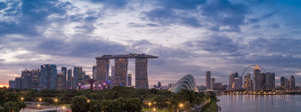 Panorama Skyline of Singapore. A panorama showing the famous Marina Bay Sands hotel, Gardens by the Bay, Singapore Flyer and Consveratories at dusk Royalty Free Stock Photos