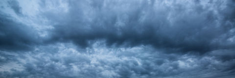 Panorama skyscape of dramatic stormy sky Stock Photos