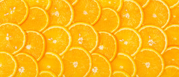 Panorama from Sliced orange background Stock Photos