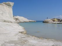 Panorama of a small creek with white moon rocks of Milos Island in Greece . stock image